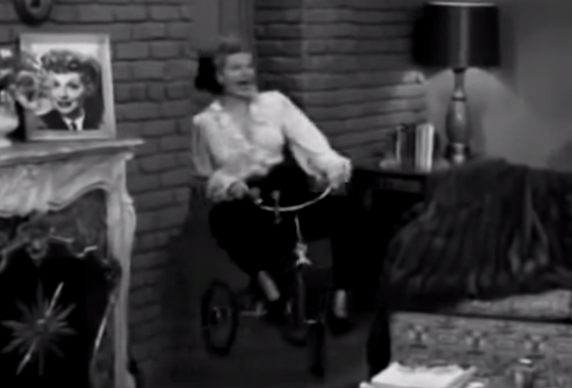 Poll: Which is creepier? The woman on the tricycle, or the photograph on the mantle?